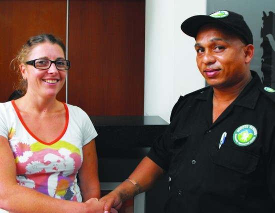 Seen here are Sarah Chantler thanking  GSCID Patrol officer, Cedric Williams, for returning her belongings which had been stolen during a theft from her vehicle