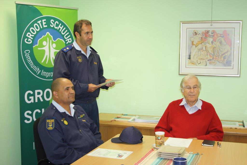 Lieutenant Colonel K R Wienand, Station Commander at Rondebosch SAPS and Sisam attended a presentation of certificates to the officers concerned at the GSCID office