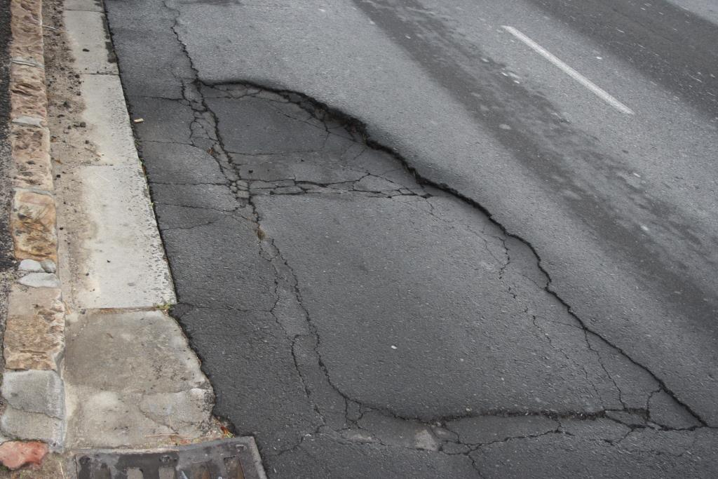 A before photograph taken of a pothole in the GSCID area and reported to the City of Cape Town Roads Department for repair