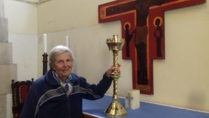Margaret Elsworth with the remaining bronze candlestick similar to the one that was recently stolen from St Paul's Church