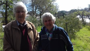 GSCID CEO, Anthony Davies and Margaret Elsworth, a concerned community member and member of St. Paul's Church Rondebosch in front of the olive grove in the grounds of St Paul's which is often the location of choice for vagrants looking for a place to bed down at night